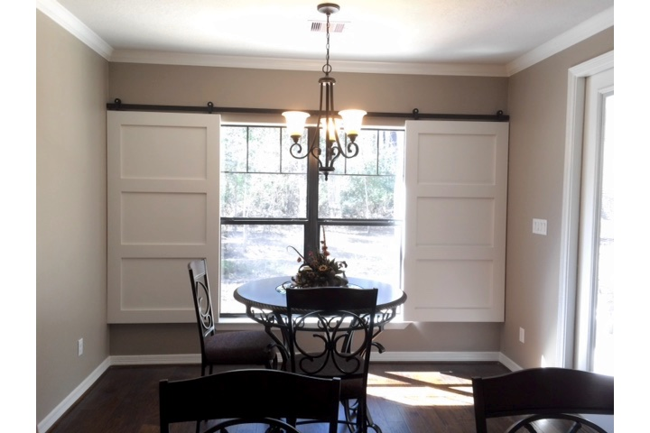 New York City dining room with sliding barn door shutters.